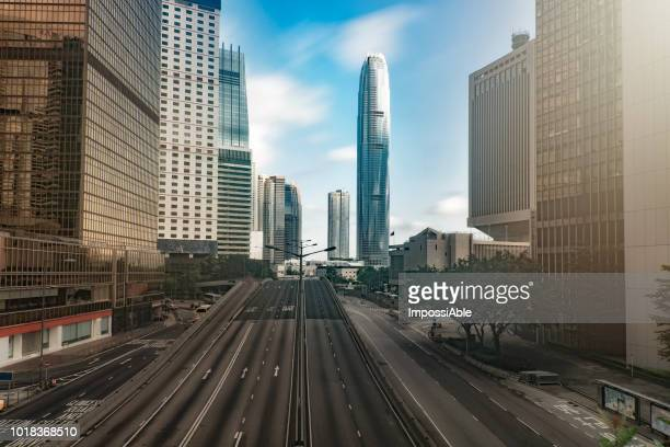 Hong kong city and office buildings with clear blue sky and almost no car