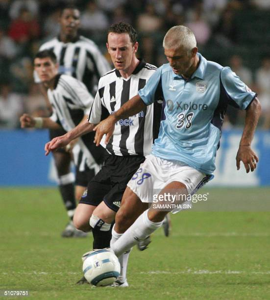 Hong Kong club Kitchee guest player Fabrizio Ravanelli from club Perugia is challenged by Newcastle United's Lee Bowyer during their exhibition...