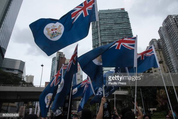Hong Kong colonial flag and flag showing Hong Kong Independence is held during a demonstration in Hong Kong Thousands joined an annual prodemocracy...