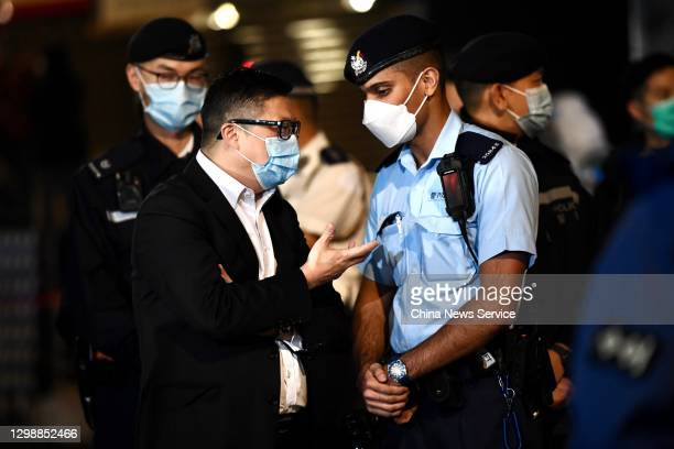 Hong Kong Commissioner of Police Chris Tang Ping-keung weaing a face mask visits an area under lockdown in Yau Ma Tei to contain the spread of...