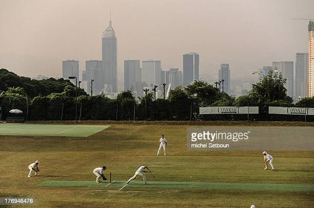 Hong Kong. Cricket club and Wanchai cityscape in the background; The last days of the british empire, before retrocession to China.