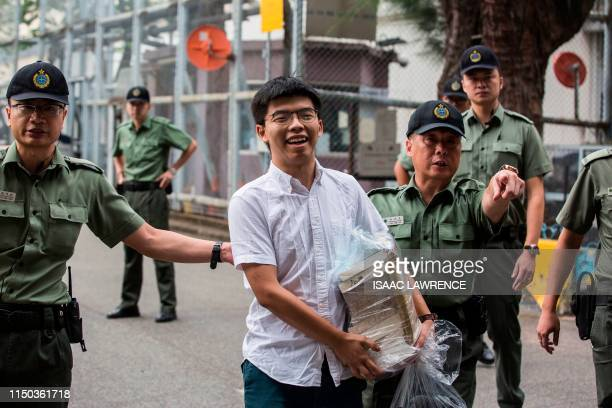Hong Kong democracy activist Joshua Wong leaves Lai Chi Kok Correctional Institute in Hong Kong on June 17, 2019. - Wong called on the city's...