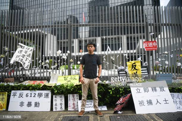 Hong Kong democracy activist Joshua Wong poses during an interview with AFP outside the government headquarters in Hong Kong on June 18 2019 Hong...