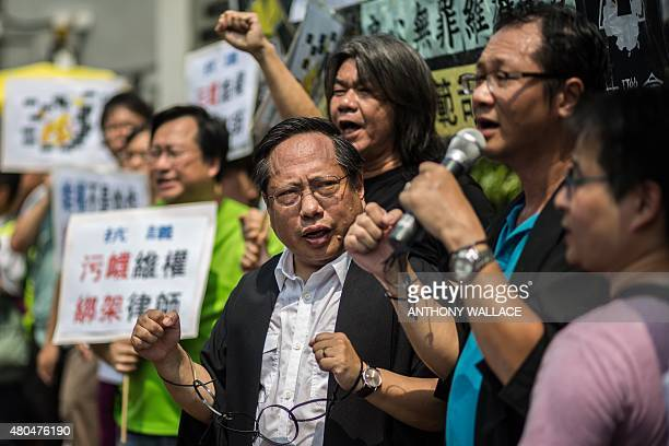 Hong Kong Democratic Party's Albert Ho wears mock handcuffs as he and legislator Leung Kwokhung known as 'Long Hair' attend a protest in Hong Kong on...