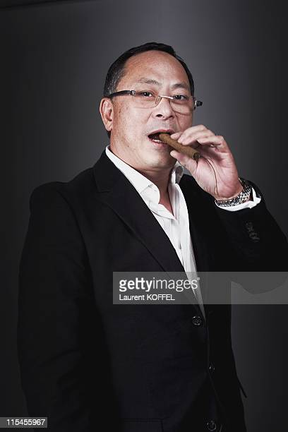 Hong Kong director Johnnie To member of the jury of the 64th Annual Cannes Film Festival poses for a portrait session during the 64th Annual Cannes...