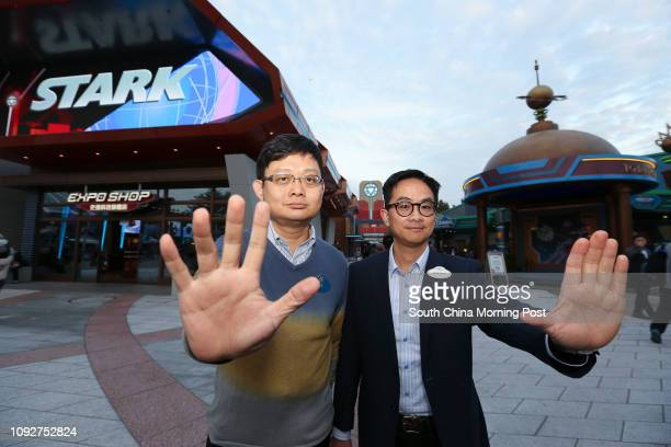 Hong Kong Disneyland Engineering Service Manager Kong Kangchuen and Attraction operations manager Johnny So pose for a photograph in front of Stark...