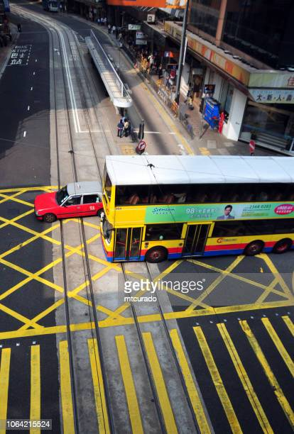 Hong Kong: double-decker bus and taxi at an intersection - Des Voeux Road - Victoria City
