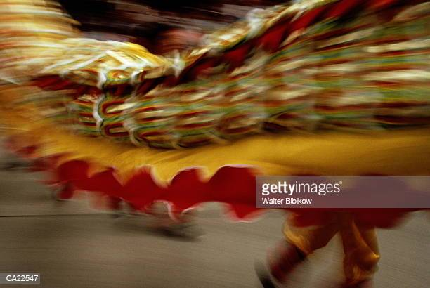 Hong Kong, dragon dancers in street (blurred motion)