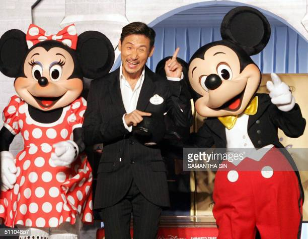 Hong Kong entertainer and theme park spokesman Jacky Cheung poses for a photo with Disney characters Minnie and Mickey Mouse at a press conference in...