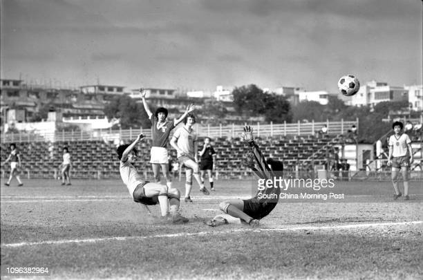 Kowloon Motor Bus soccer team's goalkeeper Wong Hofai trying to block a shot from a USD player USD thrashed KMB 40 11APR78