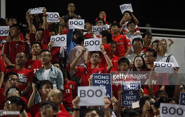 Hong Kong fans hold up signs that read 'Boo' while the national anthem was being played during a world cup qualifier at Mong Kok stadium in Hong Kong...