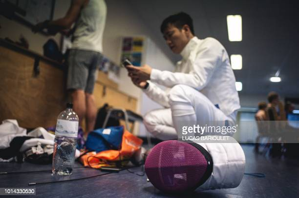 Hong Kong fencer Hon Sum Ray Lau competes during the fencing competition at the 2018 Gay Games edition at the Salle Armand Massard in Paris on August...