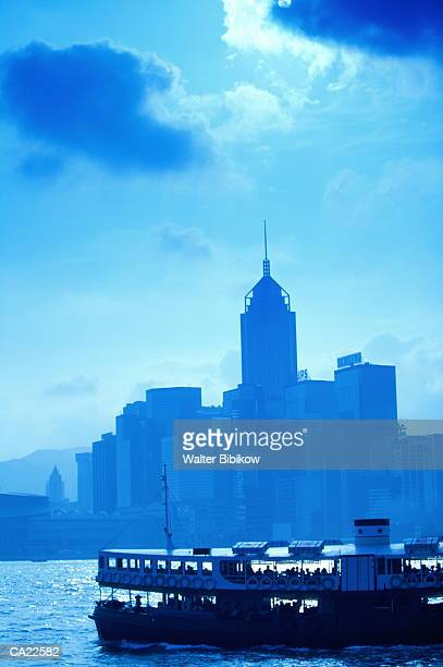 Hong Kong, ferry crossing harbour, city skyline in background