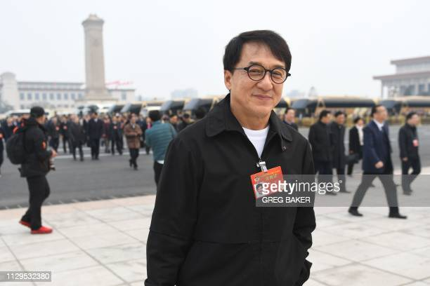 Hong Kong film actor Jackie Chan arrives at the Great Hall of the People for a plenary session of the Chinese People's Political Consultative...