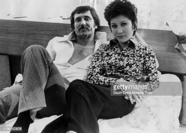 Hong Kong film star Betty Tingpei and Australian artist George Lazenby shooting a bedroom scene for the film The Shrine of Bliss 21 November 1973