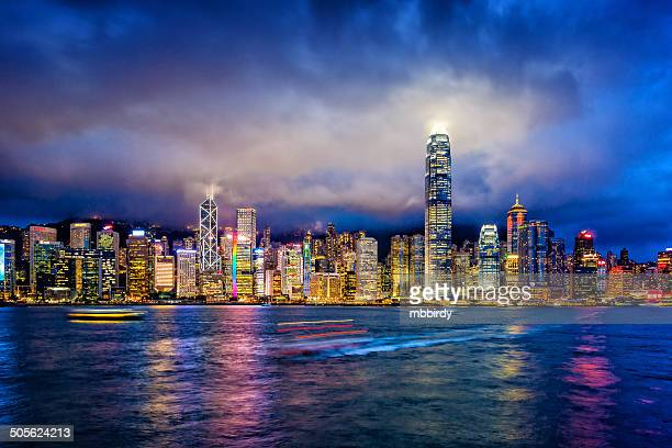 hong kong financial district at twilight - hong kong stock pictures, royalty-free photos & images