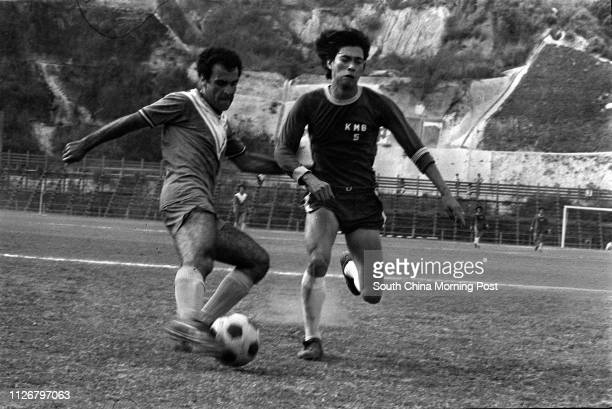 A Kowloon Motor Bus soccer team defender trying to block an attack made by Seiko striker Manuel Cuenca Seiko edged KMB by 10
