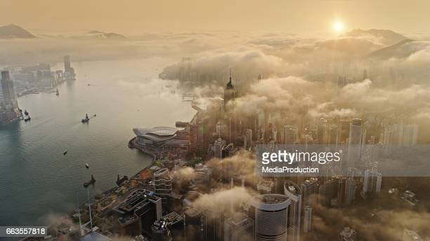 hong kong from air at sun rise - pollution stock pictures, royalty-free photos & images