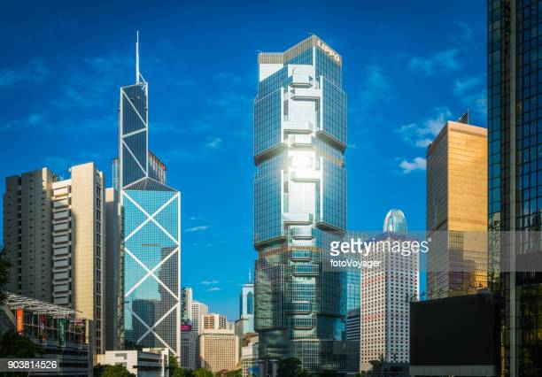 hong kong gleaming skyscrapers towering over central business district china - bank financial building stock pictures, royalty-free photos & images