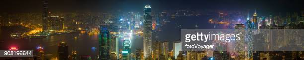 hong kong glittering skyscrapers futuristic cityscape panorama overlooking harbour china - kowloon peninsula stock pictures, royalty-free photos & images