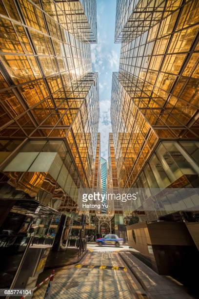 Hong Kong. Gold colored glass curtain wall of malls at China Hong Kong City
