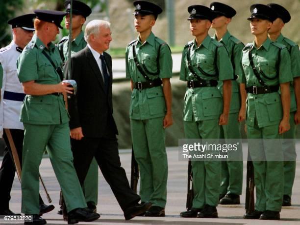 Hong Kong Governor Chris Patten walks on June 21 1997 in Hong Kong