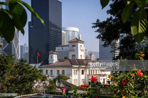hong kong governor house and skyline - colonial stock pictures, royalty-free photos & images
