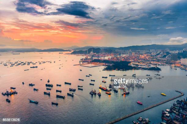 hong kong harbor view and city from above at sunset with twilight sky - hong kong victoria harbour stock pictures, royalty-free photos & images