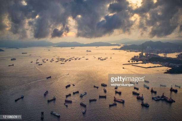 hong kong harbor view and city from above before sunset - hong kong stock pictures, royalty-free photos & images