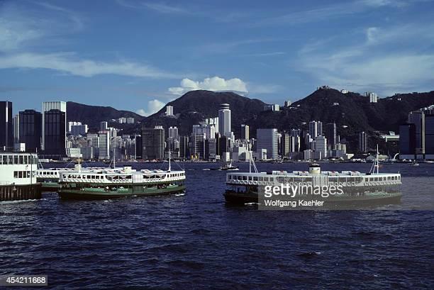 Hong Kong Harbor With Ferries Victoria Peak Background