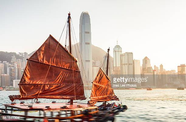 hong kong harbour cruises on a red-sail junk boat - vintage stock stock pictures, royalty-free photos & images