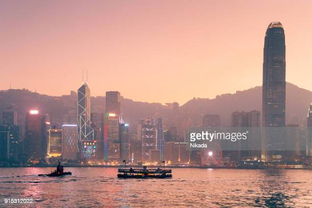 hong kong harbour skyline at dusk - star ferry stock photos and pictures