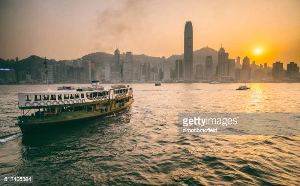hong kong harbour sunset - star ferry stock photos and pictures