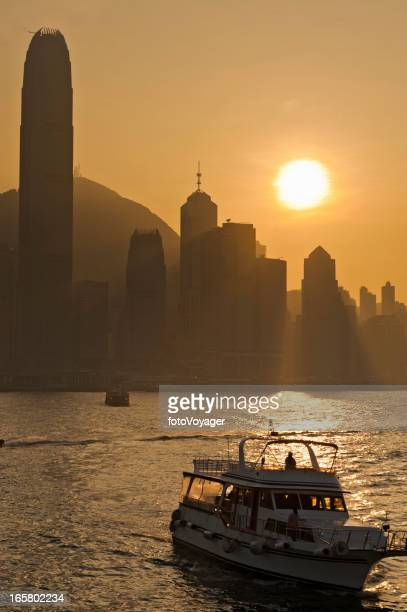 Hong Kong Harbour sunset skyscrapers bay ferries China