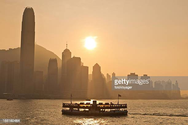 hong kong harbour sunset star ferry downtown skyscrapers china - star ferry stock photos and pictures