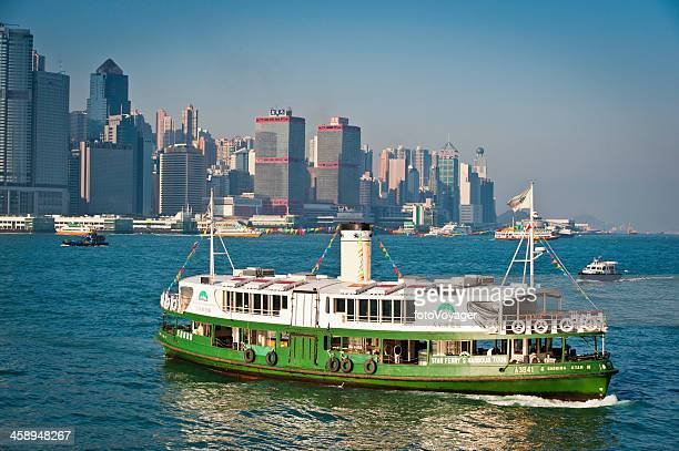 hong kong iconic star ferry crossing harbour - star ferry stock photos and pictures