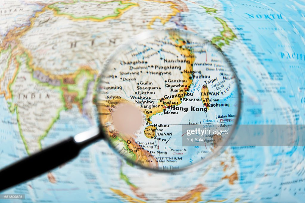 Hong kong in china and magnifying glass stock photo getty images hong kong in china and magnifying glass image of world map publicscrutiny Image collections