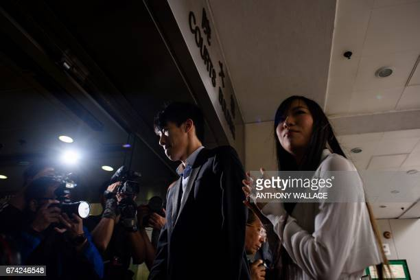 CORRECTION Hong Kong independence activists Yau Waiching and Baggio Leung arrive at the Eastern Magistrates Court for a hearing in Hong Kong on April...