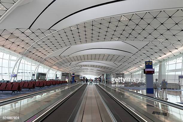 hong kong international airport midfield concourse - hong kong international airport stock photos and pictures