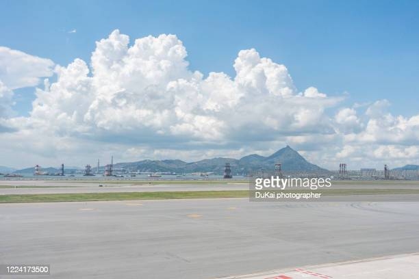 hong kong international airport - taxiway stock pictures, royalty-free photos & images