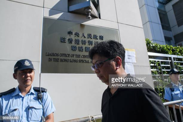 Hong Kong Journalist Association chairman Chris Yeung walks past a letter from the group displayed outside the China's Liaison Office building in...