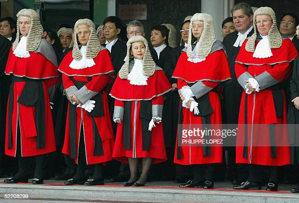 Hong Kong judges in robes and horsehair wigs attend the ceremonial opening of the Legal Year 2005 at the Hong Kong city hall 17 February 2005 Members...