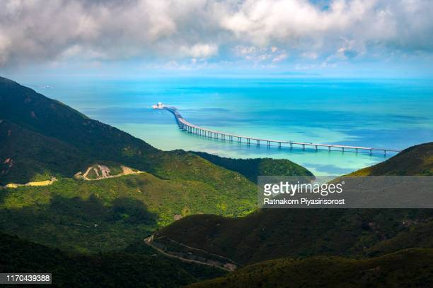 hong kong - juhai - macau bridge crossing ocean harbor - guangdong province stock pictures, royalty-free photos & images