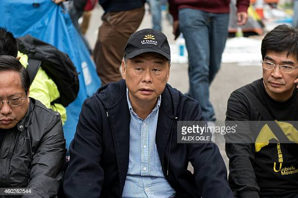Hong Kong media tycoon Jimmy Lai sits on a blocked road at the main prodemocracy protest site in the Admiralty district of Hong Kong on December 11...