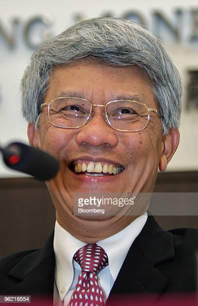Hong Kong Monetary Authority Chief Executive Joseph Yam laughs during a press conference in Hong Kong China Wednesday May 18 2005 The Hong Kong...
