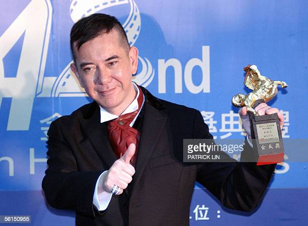 Hong Kong movie star Anthony Wong displays a trophy after winning the Best Supporting Actor at Keelung Culture Center 13 November 2005 for the 42nd...