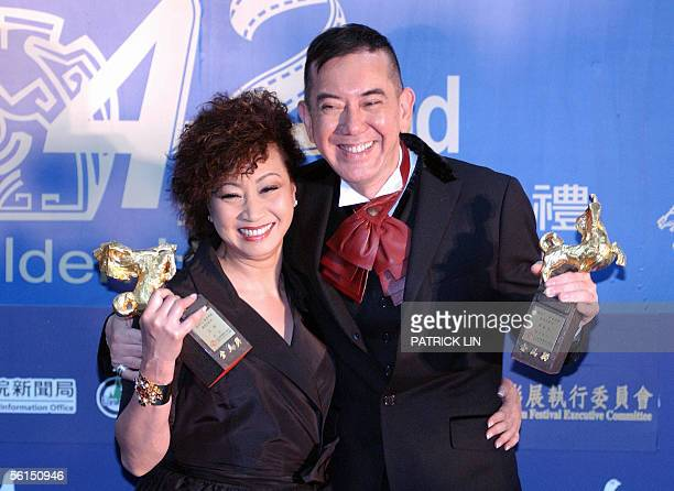 Hong Kong movie star Yuen Qiu and Anthony Wong display trophies after winning the Best Supporting Actress and Best Supporting Actor at Keelung...