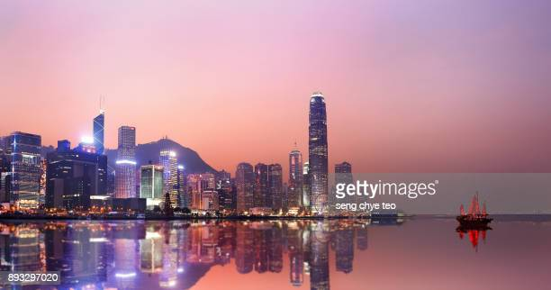 hong kong neon sunset iconic harbour skyscrapers - hong kong stock pictures, royalty-free photos & images