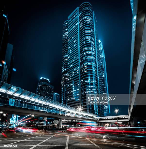 ciudad nocturna de hong kong - gigante tecnológico fotografías e imágenes de stock