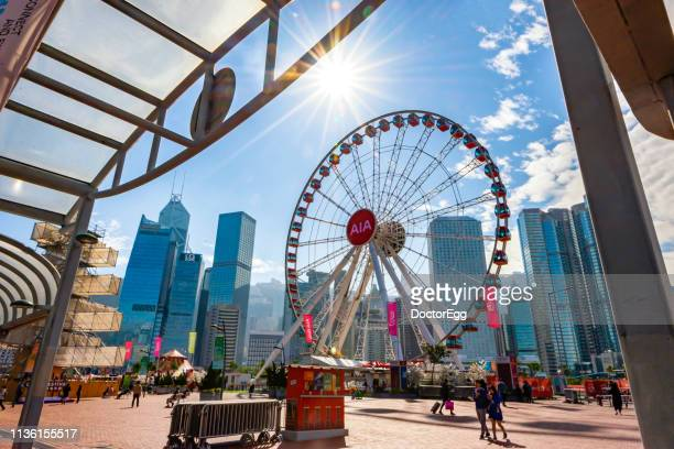 hong kong observation wheel with skyscraper building background, hong kong - hong kong stock pictures, royalty-free photos & images